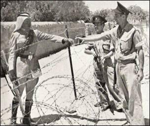 Israeli and Jordanian soldiers near the Mandelbaum gate