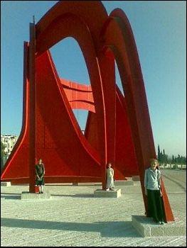 Three girls standing in modern sculpture in Jerusalem