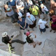 group of tourists with tour guide