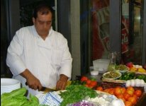 Jerusalem restaurant chef preparing Israeli salad