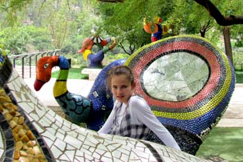 Sitting on the Niki de Saint Phalle sculptures at the Biblical Zoo