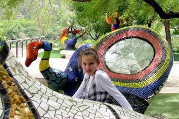 Sitting on the Niki de Saint Phalle sculptures at the Biblical Zoo