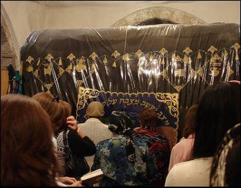 praying at Rachel's Tomb