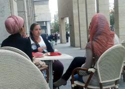Jewish and Arab women at cafe